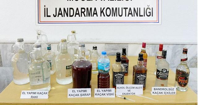Kaçak içki üreticileri yakalandı..